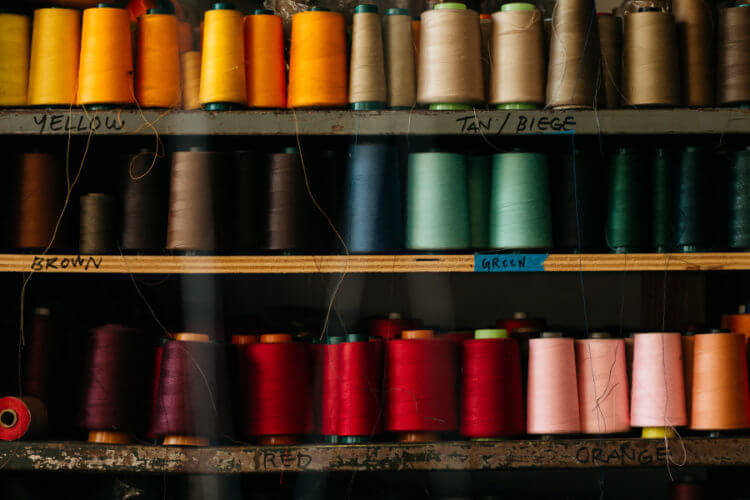 multi-colored spools of thread